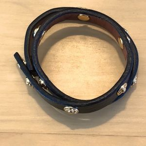 Free with purchase.Leather & gold colour bracelet.